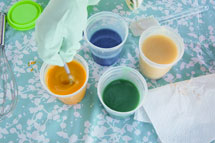 Stir soap and colour until well blended