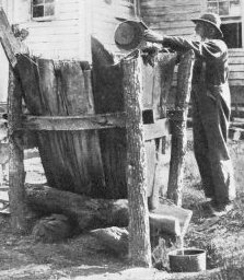Colonial Soap Maker Leaching Lye in a Hopper